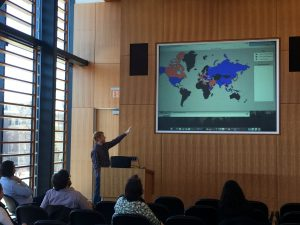 A student presenting an image of a color-coordinated map