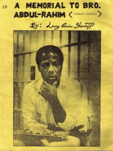 Cover of a zine featuring an image of a man sitting with a meal in a cell.