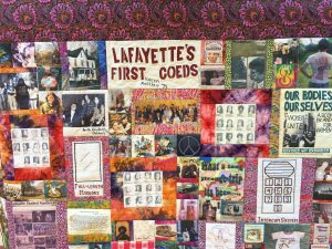 A quilt consisting of multicolored squares of fabric