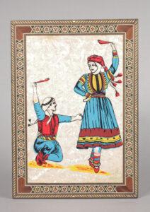 Dancing man and woman wearing traditional Lebanese dress